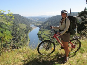 Standing above the Whanganui River, with rental bike.